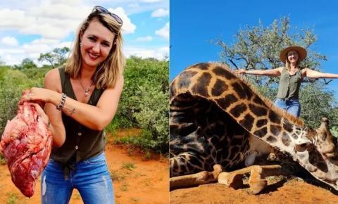 Caçadora que já matou 500 animais posa para foto com coração de girafa morta